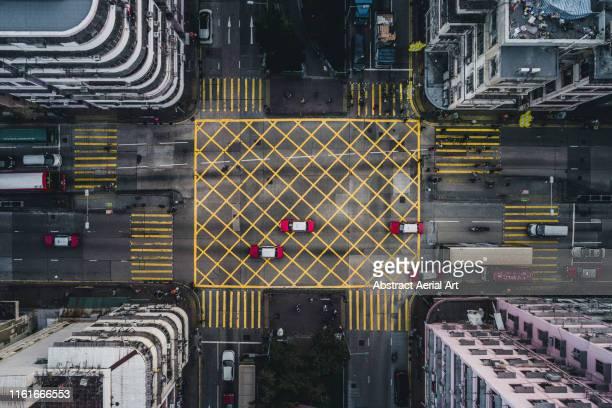 taxis on a city road intersection, kowloon, hong kong - cuadrado forma bidimensional fotografías e imágenes de stock