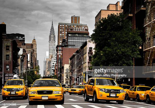 taxi's on lex - yellow taxi stock pictures, royalty-free photos & images