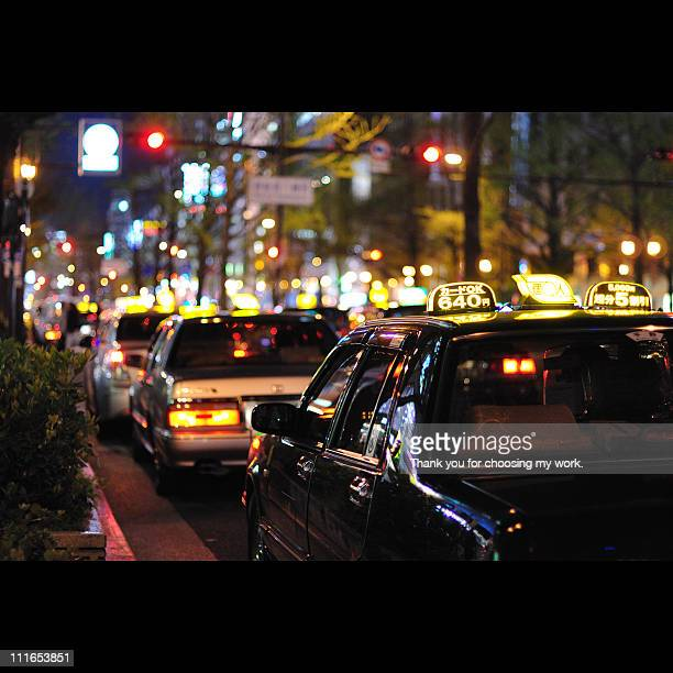 Taxis on street at night