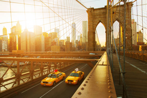 Taxis on The Brooklyn Bridge at sunset in New York