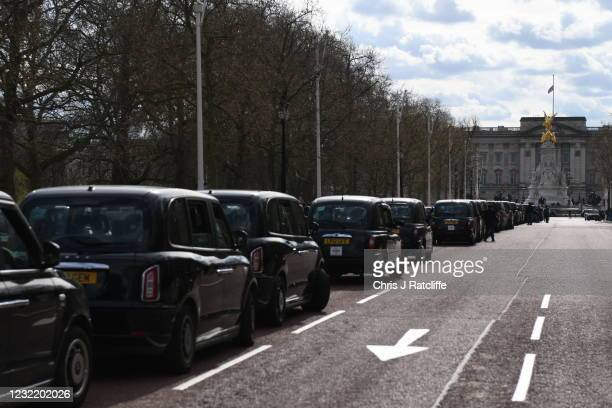 Taxis queue on The Mall towards Buckingham Palace following the death of His Royal Highness Prince Philip, Duke of Edinburgh on April 09, 2021 in...