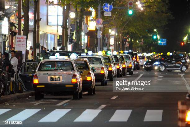 Taxis queue while waiting for customers at Susukino district on September 11 2018 in Sapporo Hokkaido Japan A male resident in Atsuma who was the...