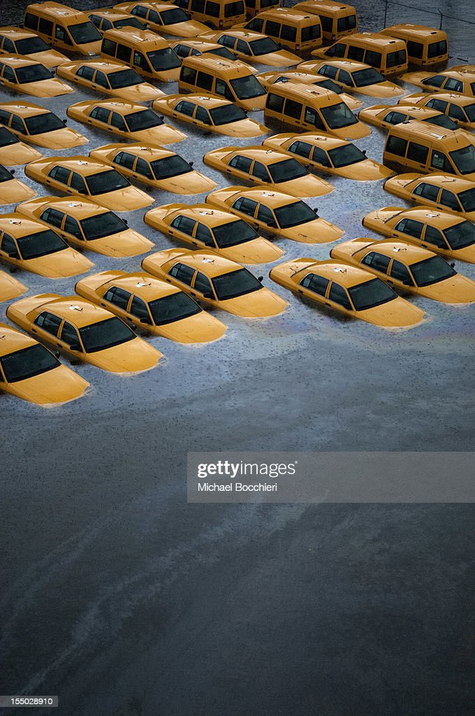 Taxis sit in a flooded lot after Hurricane Sandy October 30, 2012 in Hoboken, New Jersey.?The storm has claimed at least 40 lives in the United States and has caused massive flooding across much of the Atlantic seaboard. U.S. President Barack Obama has declared the situation a 'major disaster' for large areas of the U.S. east coast, including New York City, with widespread power outages and significant flooding in parts of the city.