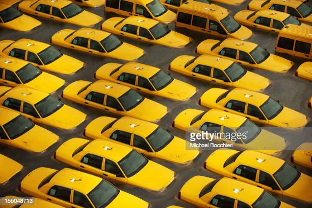 Taxis sit in a flooded lot after Hurricane Sandy October 30 2012 in Hoboken New JerseyThe storm has claimed many lives in the United States and has...