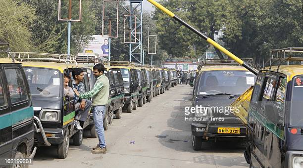 Taxis stand lined at Nizamudin Railway station as they remain off the road in support of 48 hour nationwide strike called by 11 Central Trade Unions...
