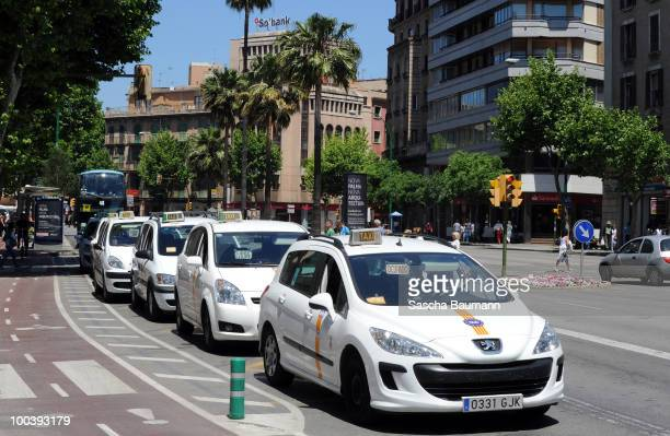 Taxis wait in the city of Palma de Mallorca for customers on May 24 2010 in Palma de Mallorca Spain