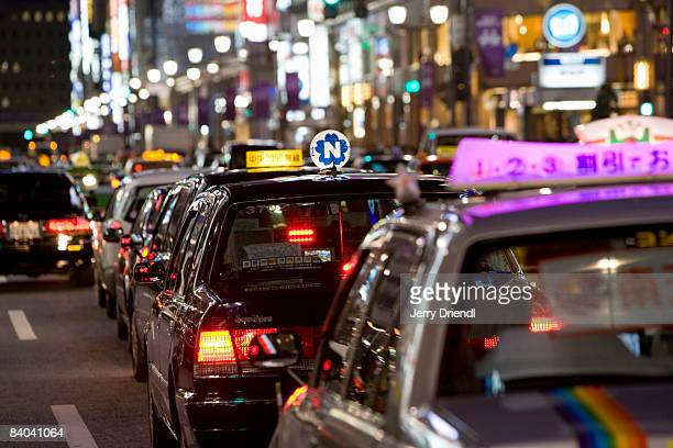 Taxis waiting in traffic on Chuo Street in Ginza