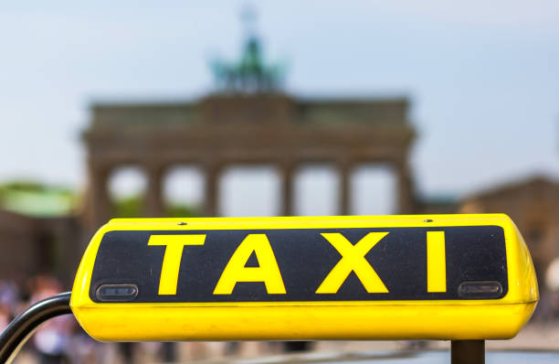 Taxi-Sign with Brandenburg Gate in the background (Berlin, Germany)