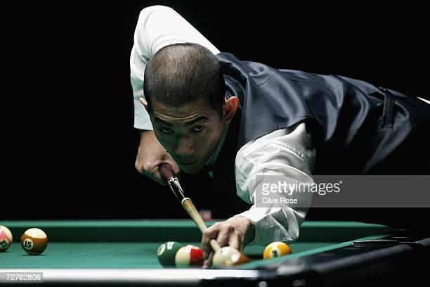 Tay Choon Kiat of Singapore ponders his next shot during the last 32 Men's 8Ball pool singles match against Satoshi Kawabata of Japan at the 15th...