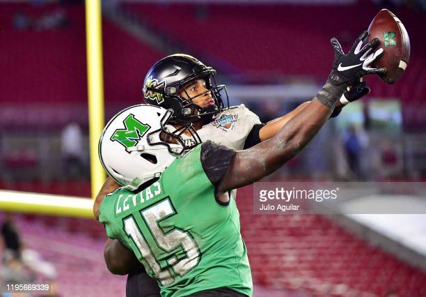 Tay Gowan of the UCF Knights breaks up a pass intended for Armani Levias of the Marshall Thundering Herd during the fourth quarter at the Bad Boy...