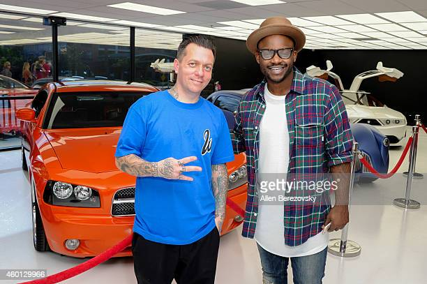 Tay James and founder for West Coast Customs Ryan Friedlinghaus attend the Grand Opening of West Coast Customs Burbank Headquarters at West Coast...