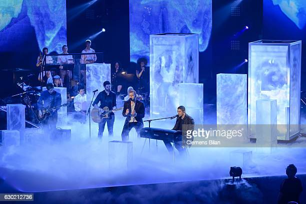 Tay Schmedtmann and Andreas Bourani perform during the ''The Voice Of Germany' Finals' on December 18 2016 in Berlin Germany