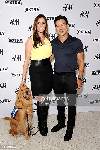 Taya Kyle and Mario Lopez pose on the set of Extra at their New York studios at HM in Times Square on September 8 2015 in New York City