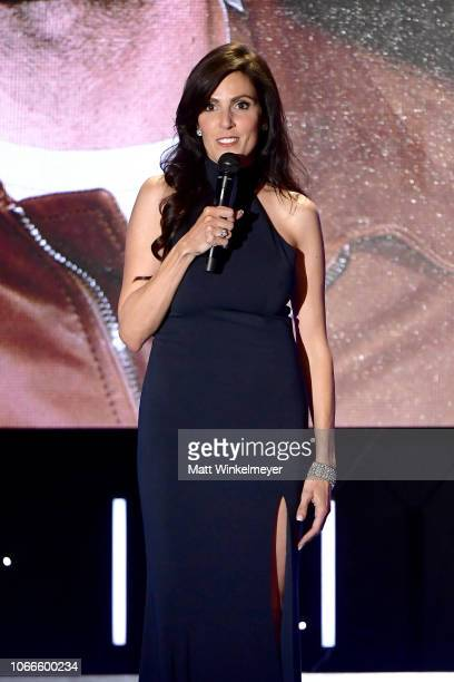 Taya Kyle speaks onstage during the 32nd American Cinematheque Award Presentation honoring Bradley Cooper at The Beverly Hilton Hotel on November 29...