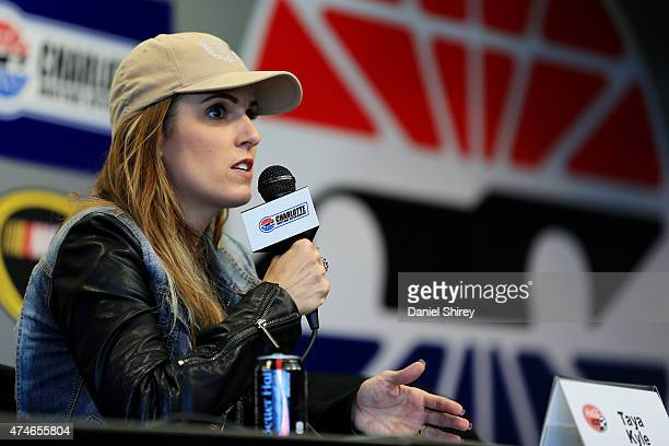 Taya Kyle widow of American Sniper Chris Kyle speaks to the media during a press conference prior to the NASCAR Sprint Cup Series CocaCola 600 at...
