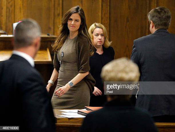 Taya Kyle wife of former Navy SEAL Chris Kyle gives a wink to Judy Littlefield mother of Chad Littlefield during the capital murder trial of former...