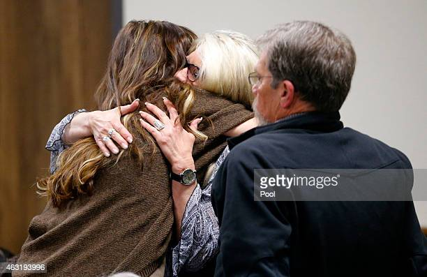 Taya Kyle wife of slain Navy SEAL Chris Kyle hugs family members after they arrive for the opening day of the capital murder trial of former Marine...