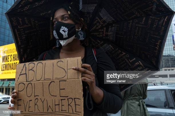 Taya Myree listens to a speaker before she and fellow demonstrators march to the National Center for Civil and Human Rights while protesting the...