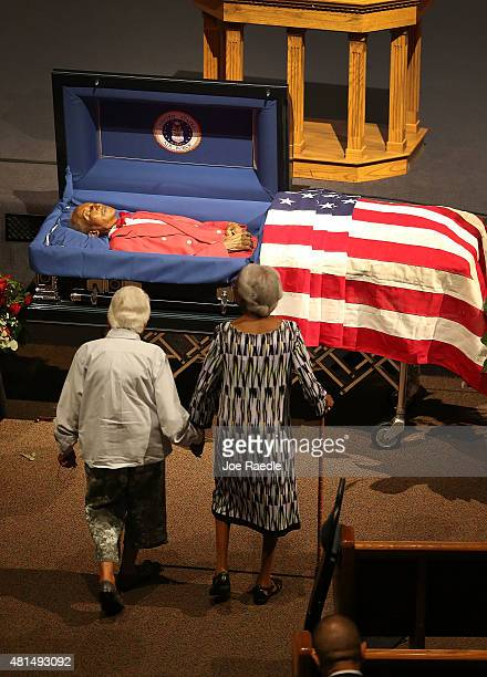 Taya Seligman and Lucille Wiggins approach the coffin to pay their respects to Lucille's longtime neighbor Retired Air Force Lt Col Eldridge Williams...