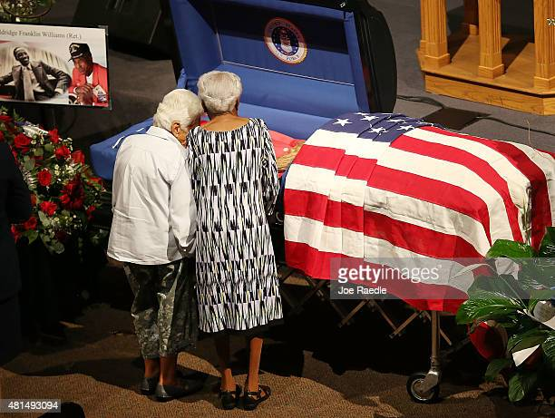 Taya Seligman and Lucille Wiggins pay their respects to Lucille's longtime neighbor Retired Air Force Lt Col Eldridge Williams at the Sweet Home...