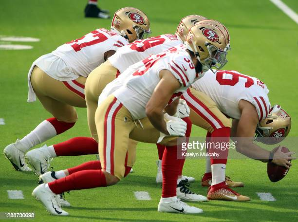 Taybor Pepper of the San Francisco 49ers prepares to snap the ball against the Los Angeles Rams during the first quarter at SoFi Stadium on November...