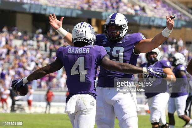 Taye Barber and Coy McMillon of the TCU Horned Frogs celebrate a third quarter touchdown against the Iowa State Cyclones at Amon G. Carter Stadium on...