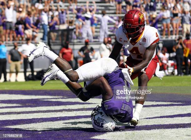 Taye Barber of the TCU Horned Frogs tumbles in the end zone after a touchdown reception against Arnold Azunna of the Iowa State Cyclones at Amon G....