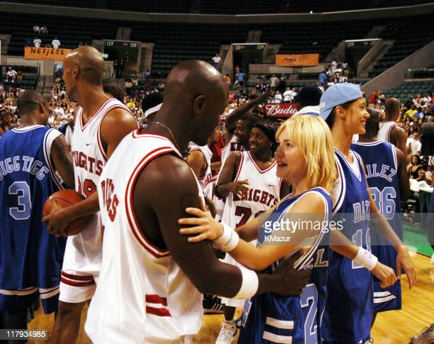 Taye Diggs and Elisha Cuthbert during *NSYNC's Challenge for the Children V - Post Game at Office Depot Center in Fort Lauderdale, Florida, United...