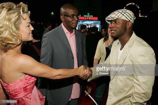 Taye Diggs and Kelly Carlson during Maxim Magazine's Hot 100 Red Carpet at The Day After in Hollywood California United States