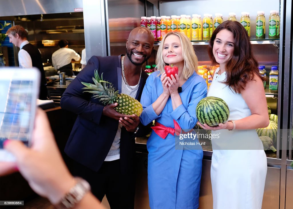 Taye Diggs and Kristen Bell poses with guest at the 2017 #DrinkGoodDoGood Campaign Launch at Little River on August 9, 2017 in New York City.