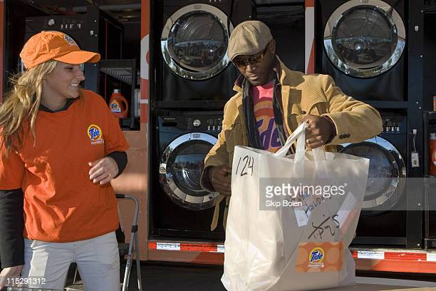 Taye Diggs folds and packs laundry at Tide's Mobile Laundromat in New Orleans December 17 2007 The Tide CleanStart truck is a mobile laundromat...