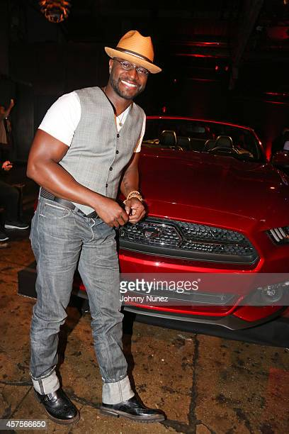 Taye Diggs poses in front of an allnew 2015 Mustang at the Ford and Hard Rock Hotels Casinos event 'The Mustang Roadhouse' in New York City on Monday...