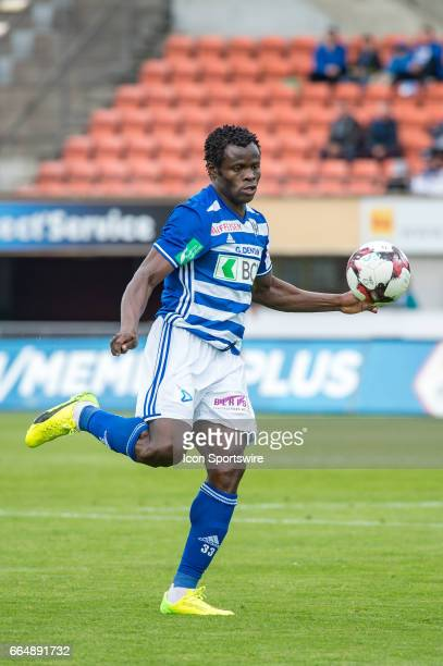 Taye Taiwo passes the ball during the Swiss Super League match between FC LausanneSport and Grasshopper Club Zurich on April 02 at Stade Olympique de...