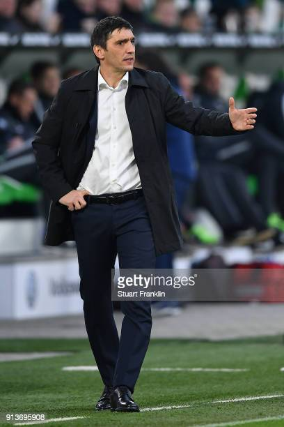 Tayfun Korkut coach of Stuttgart gestures during the Bundesliga match between VfL Wolfsburg and VfB Stuttgart at Volkswagen Arena on February 3 2018...