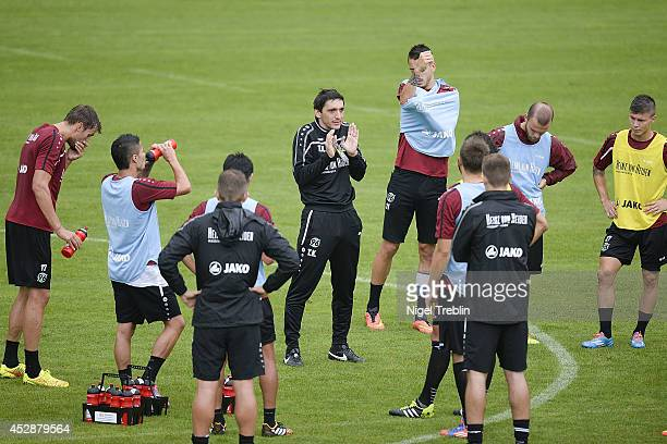 Tayfun Korkut head coach of Hannover gestures on the pitch during a training session at Hannover 96 training camp on July 28 2014 in Mureck Austria