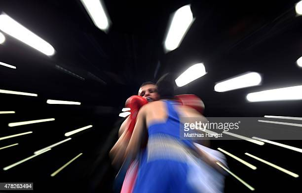 Tayfur Aliyev of Azerbaijan and Bakhtovar Nazirov of Russia compete in the Men's Bantamweight Semi Final during day twelve of the Baku 2015 European...