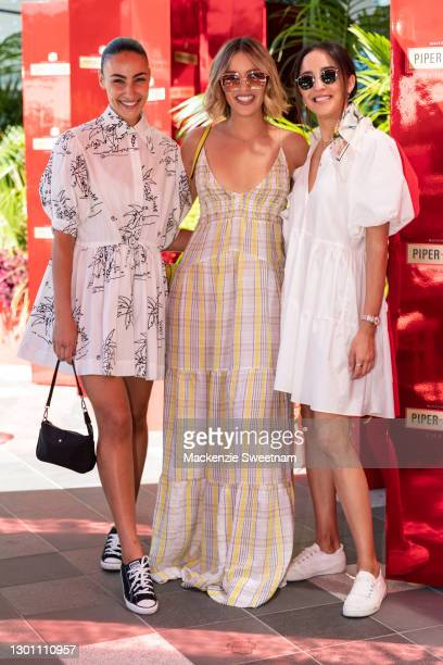 Tayla Damir, Olivia Molly Rogers and Abbey Gelmi attend the Piper-Heidsieck Champagne Bar during the 2021 Australian Open at Melbourne Park on...