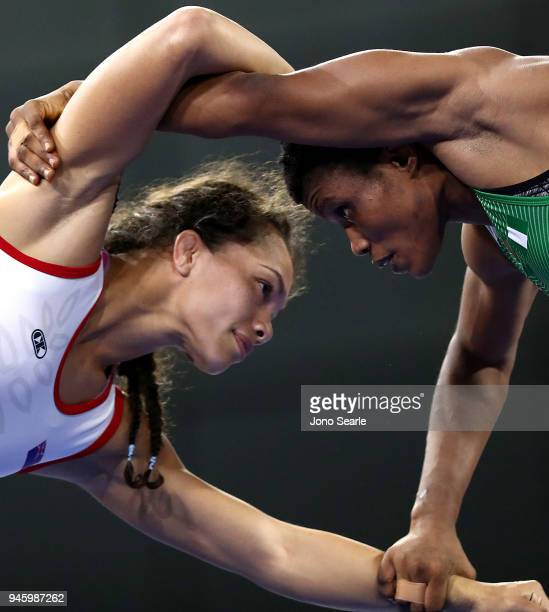 Tayla Ford of New Zealand competes against Aminat Adeniyi of Nigeria in the women's 62kg round during Wrestling on day 10 of the Gold Coast 2018...