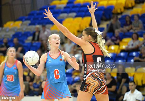 Tayla Fraser of the Waratahs looks to pass during the round seven Australian Netball League match between the Storm and the Waratahs at University of...