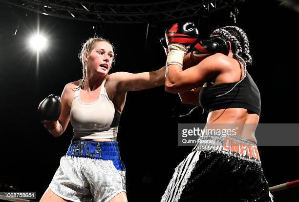 Tayla Harris and Sarah Dwyer exchange punches during the Australian Title Fight between Tayla Harris and Sarah Dwyer at Melbourne Pavillion on...
