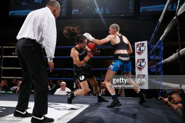 Tayla Harris knocks down Janay Harding during the Australian Female Super Welterweight Boxing Title match during Big Time Boxing at the Melbourne...