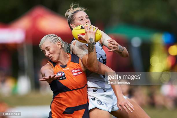 Tayla Harris of Carlton attempts to take a mark over Renee Tomkins of the Giants during the round three AFLW match between the Greater Western Sydney...