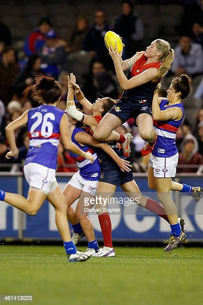 Tayla Harris of Melbourne takes a high mark during the women's exhibition AFL match between the Western Bulldogs and the Melbourne Demons at Etihad...
