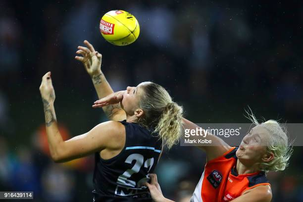 SYDNEY AUSTRALIA FEBRUARY Tayla Harris of the Blues attempts to mark under pressure from Renee Tomkins of the Giants during the round 20 AFLW match...