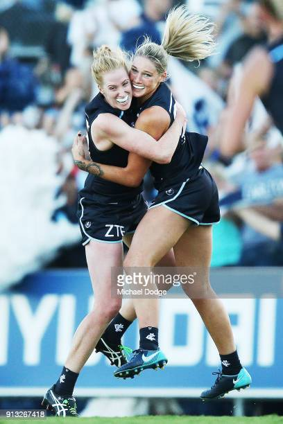 Tayla Harris of the Blues celebrates a goal with Kate Shierlaw during the round one AFLW match between the Carlton Blues and the Collingwood Magpies...