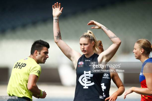 Tayla Harris of the Blues is reported for a dangerous tackle on Emily Bates of the Lions during the AFLW Semi Final match between the Carlton Blues...