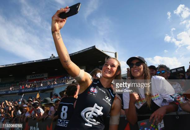 Tayla Harris of the Blues is seen taking a selfie with fans after the AFLW Preliminary Final match between the Carlton Blues and the Fremantle...