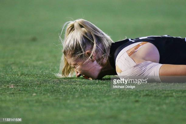 Tayla Harris of the Blues looks in pain after hurting her shoulder during the round five AFLW match between the Carlton Blues and the Collingwood...