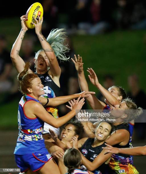 Tayla Harris of the Blues marks the ball over Eleanor Brown of the Bulldogs during the 2021 AFLW Round 02 match between the Western Bulldogs and the...