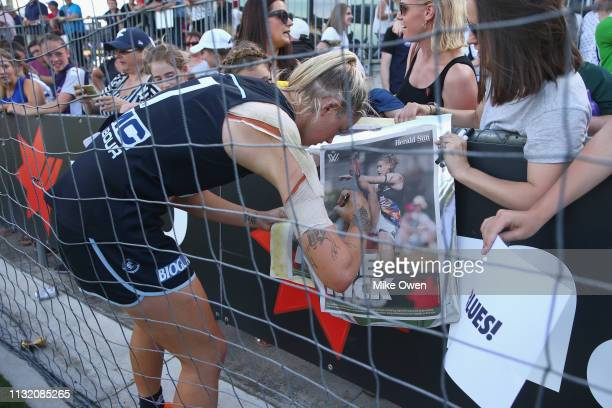 Tayla Harris of the Blues signs a poster of herself after the AFLW Preliminary Final match between the Carlton Blues and the Fremantle Dockers at...